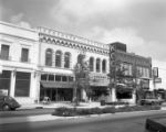 1300 block of Main, Wright-Johnson Inc., Jackson Camera Center, Zipkleen, and Friendly Cafeteria...