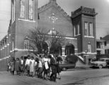 African-American civil rights demonstrators parading before Zion Baptist Church
